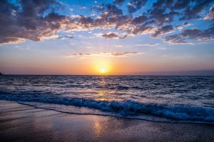 beautiful sunset over the beach buy a second home