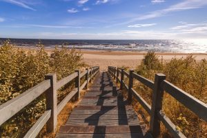wooden walkway to beach buying a second home